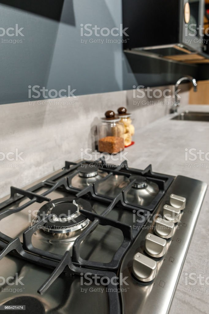 Interior of modern kitchen with metal stove on counter royalty-free stock photo
