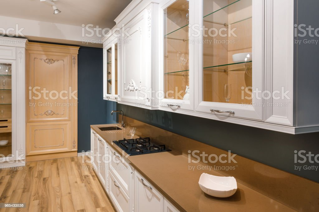 Interior of modern kitchen with stylish design and stove on counter zbiór zdjęć royalty-free