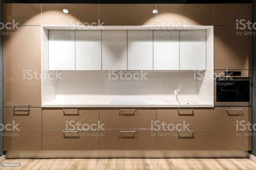 Interior of modern kitchen with stylish design in brown and white colors royalty-free stock photo