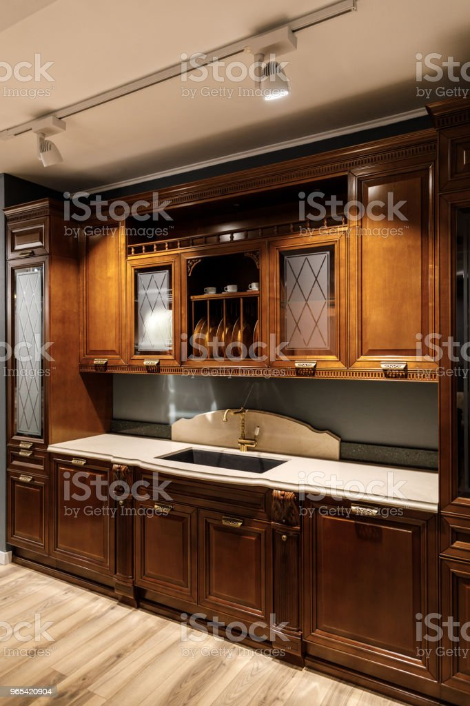 Interior of modern kitchen with wooden cabinets zbiór zdjęć royalty-free