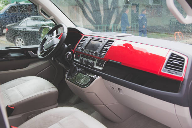 Interior of modern Volkswagen Multivan California Ocean (Transporter T6). cockpit panel, driver and passenger seats. stock photo