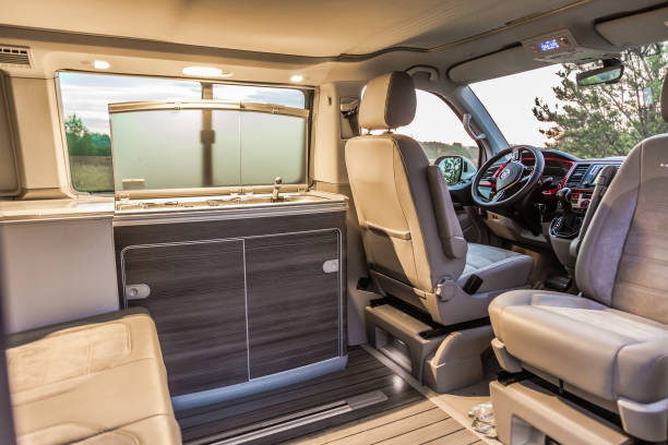 Interior of modern Volkswagen Multivan California Ocean (Transporter T6).  Kitchen inside the car stock photo