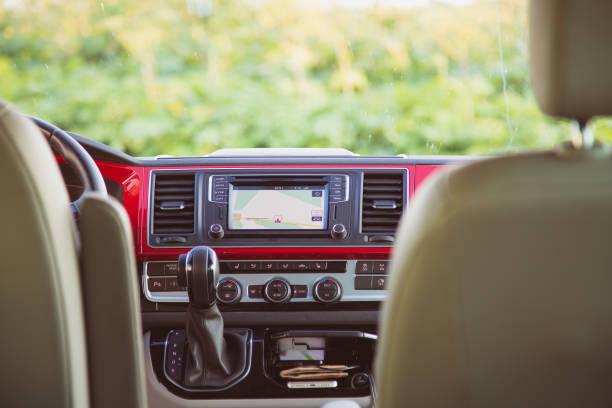 Interior of modern Volkswagen Multivan California Ocean (Transporter T6). Multimedia head unit, climate control and gear shift stock photo