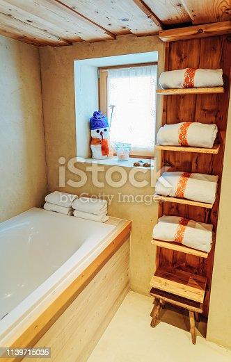 800987054istockphoto Interior of modern white bathroom with wood design bathtub 1139715035