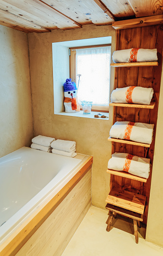 800987054 istock photo Interior of modern white bathroom with wood design bathtub 1139715035