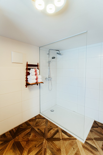618327092 istock photo Interior of modern white bathroom with wood design shower 1139714939