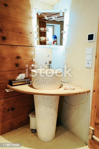 istock Interior of modern white bathroom with wood design sink mirror 1139715281