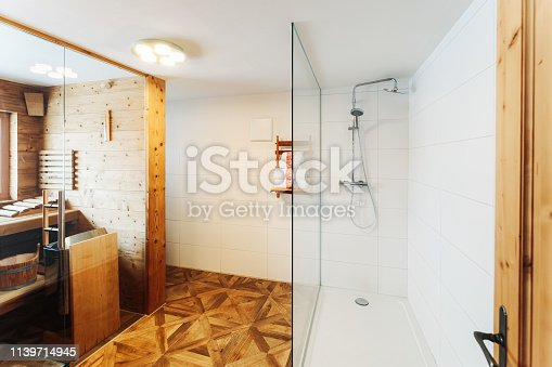 819534860istockphoto Interior of modern white bathroom with wood design sink shower 1139714945