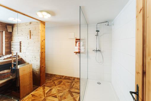 800987054 istock photo Interior of modern white bathroom with wood design sink shower 1139714945