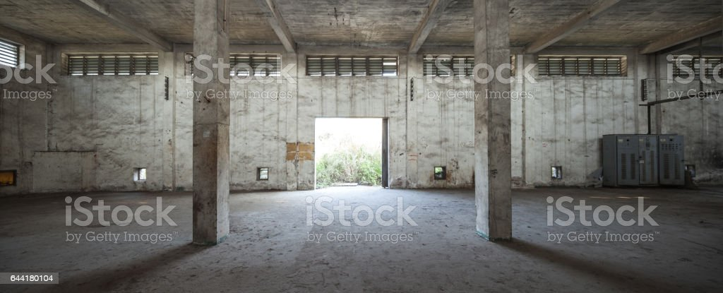 Interior of old and abandoned factory warehouse stock photo
