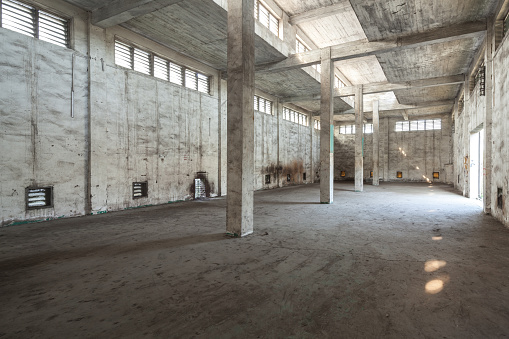 Interior of old and abandoned factory warehouse.