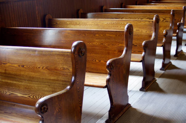 Interior of old church with carved wooden pews Carved Wooden pews in church in sunshine pew stock pictures, royalty-free photos & images