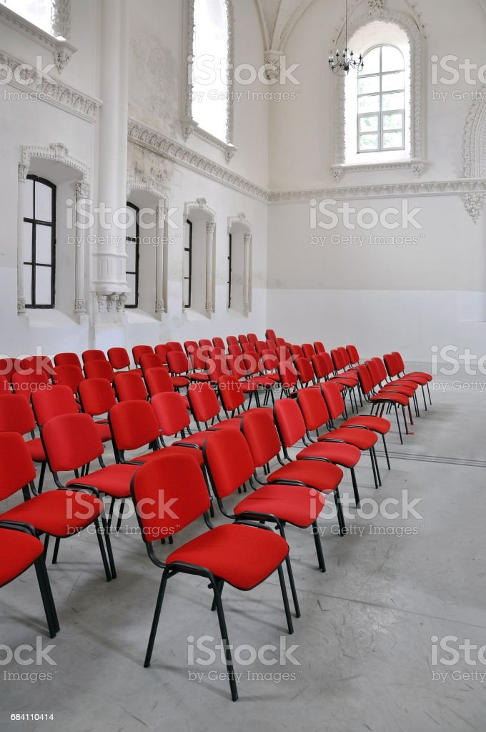Interior Of Old Synagogue Rows Of Red Chairs Against The White ...