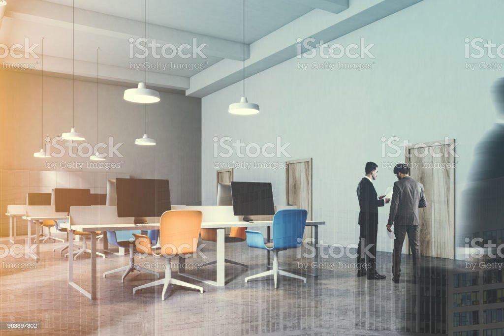 Interior of orange and blue chairs office toned - Zbiór zdjęć royalty-free (Biurko)