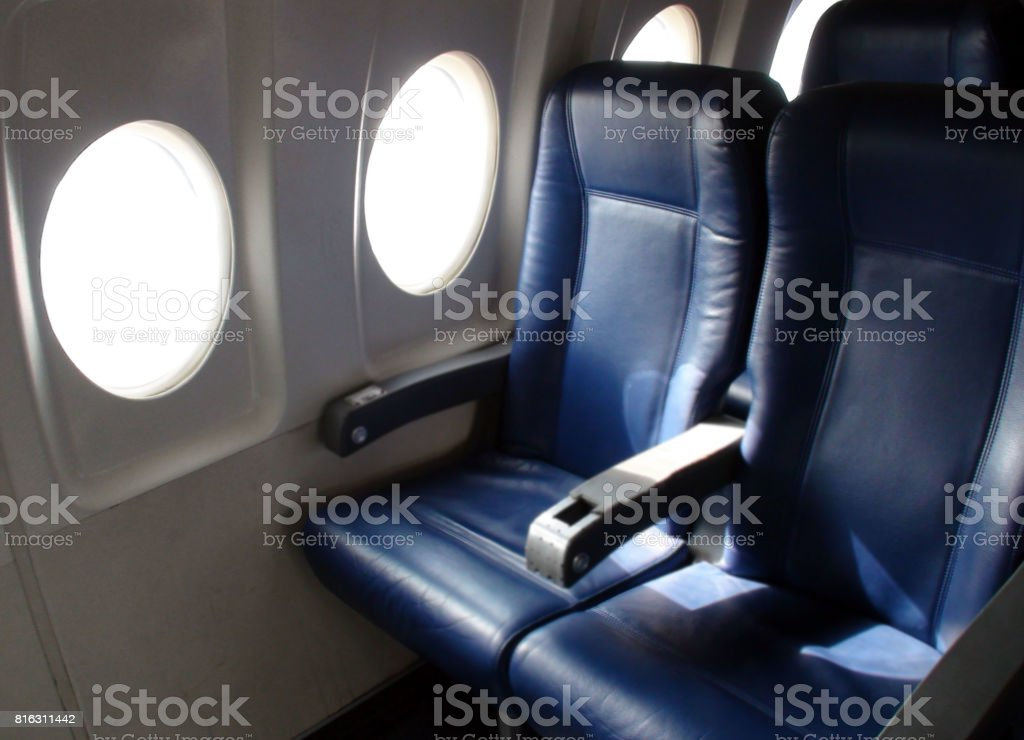 Interior Of Passengers Airplane With Empty Seats Scenery At Airport stock photo