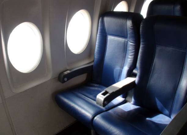 Interior Of Passengers Airplane With Empty Seats Scenery At Airport Interior Of Passengers Airplane With Empty Seats Scene At Airport airplane seat stock pictures, royalty-free photos & images