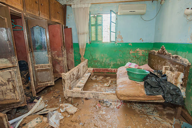 interior of poor african house following flooding disaster - flooded room stock photos and pictures