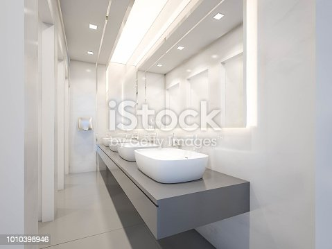 istock Interior of public toilet with ceramic basins and frameless mirror, 3d rendering 1010398946