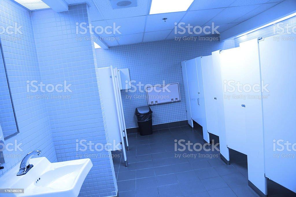 Interior of public washroom with blue toned royalty-free stock photo