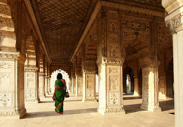 Interior of Red Fort, Delhi, India Indian Woman Walking in the Red Fort, Delhi, India agra stock pictures, royalty-free photos & images