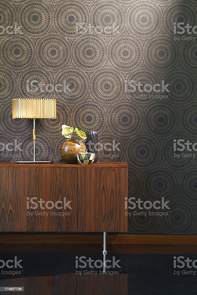 Interior of retro style cabinet against wallpaper stock photo