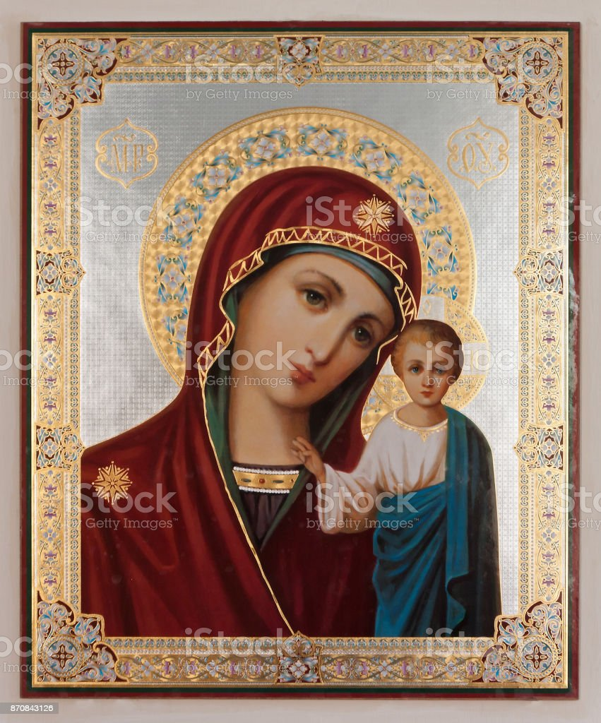Interior of russian christian orthodox church (detail): icon of the virgin Mary with Jesus baby decorated by golden plate. stock photo