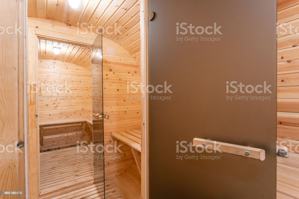 interior of sauna. rural mobile wooden bath in the form of a barrel in a pine forest zbiór zdjęć royalty-free
