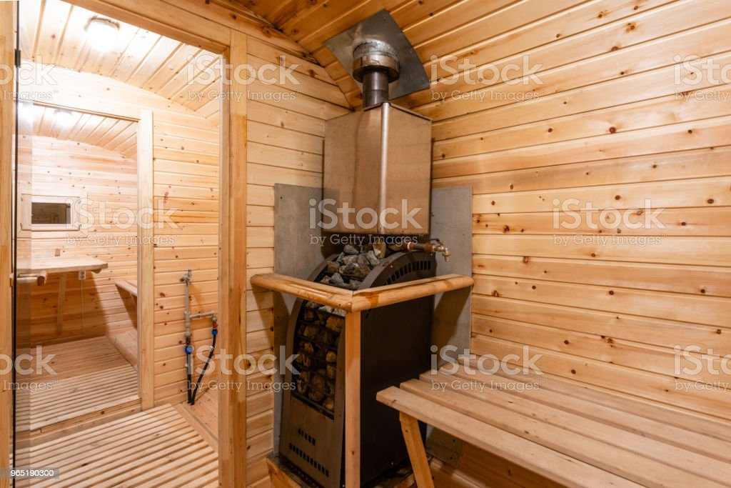 interior of sauna. rural mobile wooden bath in the form of a barrel in a pine forest royalty-free stock photo