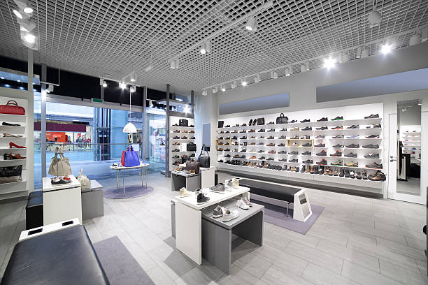 interior of shoe store in modern european mall - store stock pictures, royalty-free photos & images