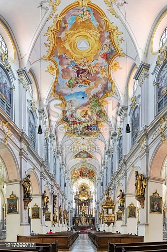 Munich, Germany - May 30, 2017: Interior of St. Peter's Church (Alter Peter). This is the oldest church in the city. The present interior is the result of the Late Baroque transformation in the 18th century. The high altar was created by Nikolaus Gottfried Stuber, Johann Georg Greiff, Egid Quirin Asam and Erasmus Grasser in 1730-1734. The stucco and ceiling fresco and was created by the German painter and stucco plasterer Johann Baptist Zimmermann in 1753-1756.