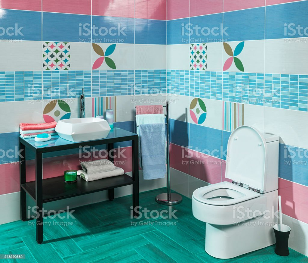 Interior of stylish modern bathroom with blue and pink tiles stock photo