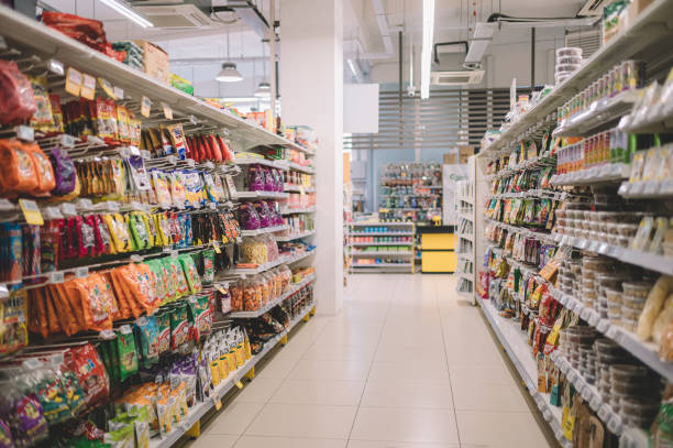 interior of supermarket full of grocery items in rows with shelf displayed interior of supermarket snack aisle stock pictures, royalty-free photos & images