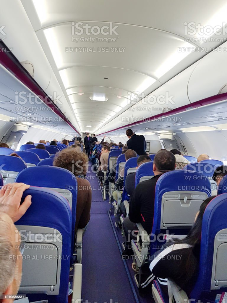 Interior Of The Airplane Cabin Of Wizz Air Airlines With Passengers On Seats Waiting To Take Off Stock Photo Download Image Now Istock