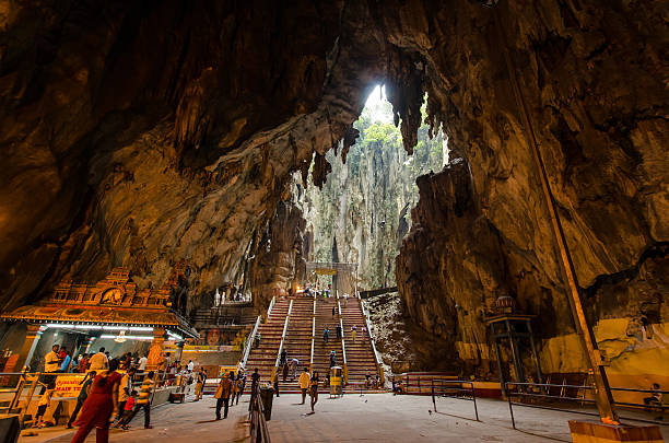Interior of the Batu Caves Kuala Lumpur,Malaysia Kuala Lumpur,Malaysia - August 3, 2014:People can seen exploring and praying in the Hindu Temple in Batu Caves Kuala Lumpur Malaysia. kuala lumpur batu caves stock pictures, royalty-free photos & images