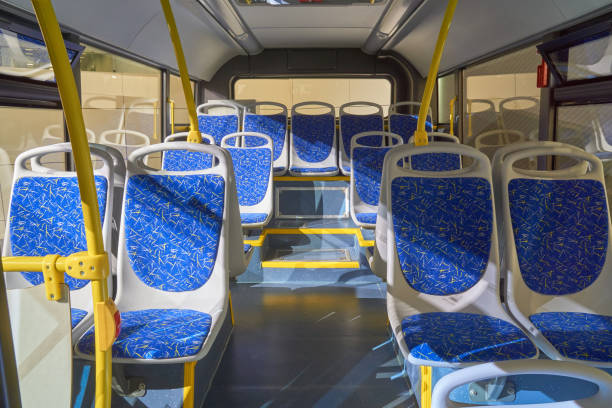 Interior of the bus Interior of modern bus with passenger seats seat stock pictures, royalty-free photos & images