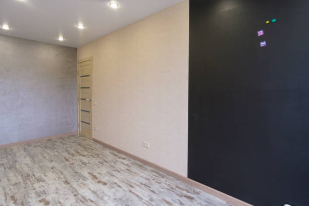 interior of the living room after repair the interior of the room in an apartment building after cosmetic repairs plaster ceiling design stock pictures, royalty-free photos & images