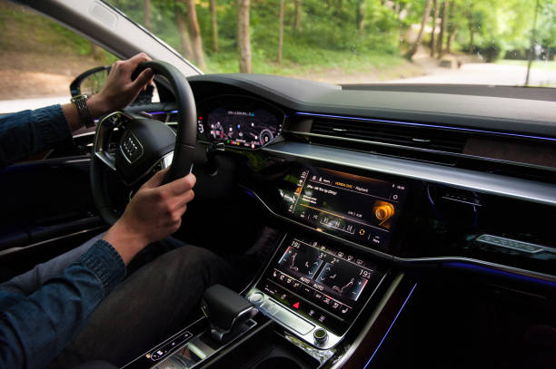 Interior of the new 2018 Audi A8 50 TDI quattro on the street. stock photo