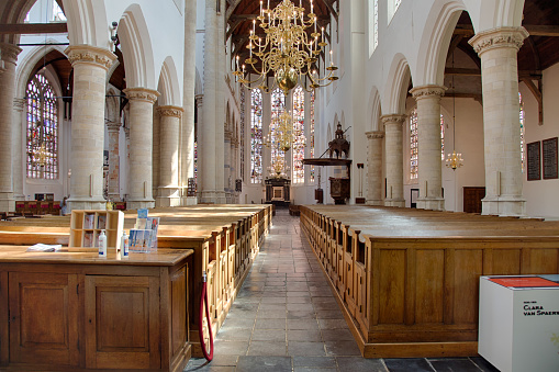 Delft, Netherlands, June 2021: Interior of the Oude Kerk (Old Church) situated in the ancient old city center of Delft