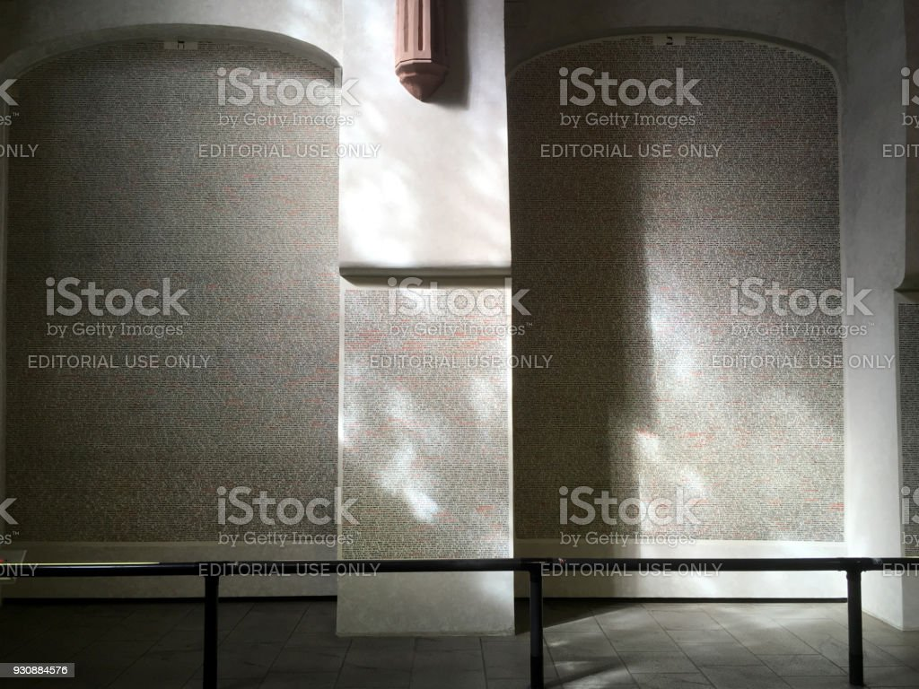 Interior of the Pinkasova Synagogue. Names hand written on the wall of Jews in the community killed in the Holocaust in WWII. Remembering the victims of war. stock photo