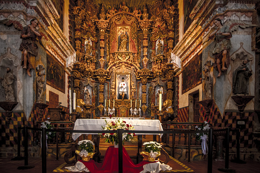 Tucson, Arizona, USA - May 3, 2019: Interior of the San Xavier Mission in Tucson. The mission is the oldest remaining European structure in Arizona. The Franciscan Catholic Mission was completed in 1791 and remains open for worship and services today.