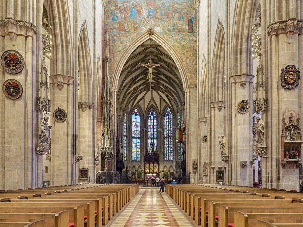 Interior of the Ulm Minster, Germany Ulm, Germany - December 16, 2017: Interior of the Ulm Minster, Germany. The church was laid in 1377, consecrated in 1405 and completed in 1890. Last Judgment fresco above the choir arch was painted in 1471 by Hans Schuchlin. ulm minster stock pictures, royalty-free photos & images