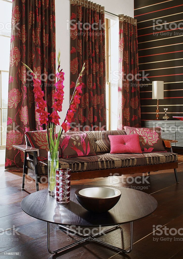 Interior of three seater sofa in colourful living room stock photo