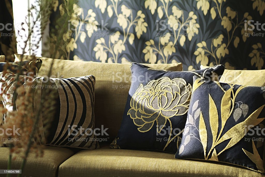 Interior of three seater sofa with cushions in living room stock photo