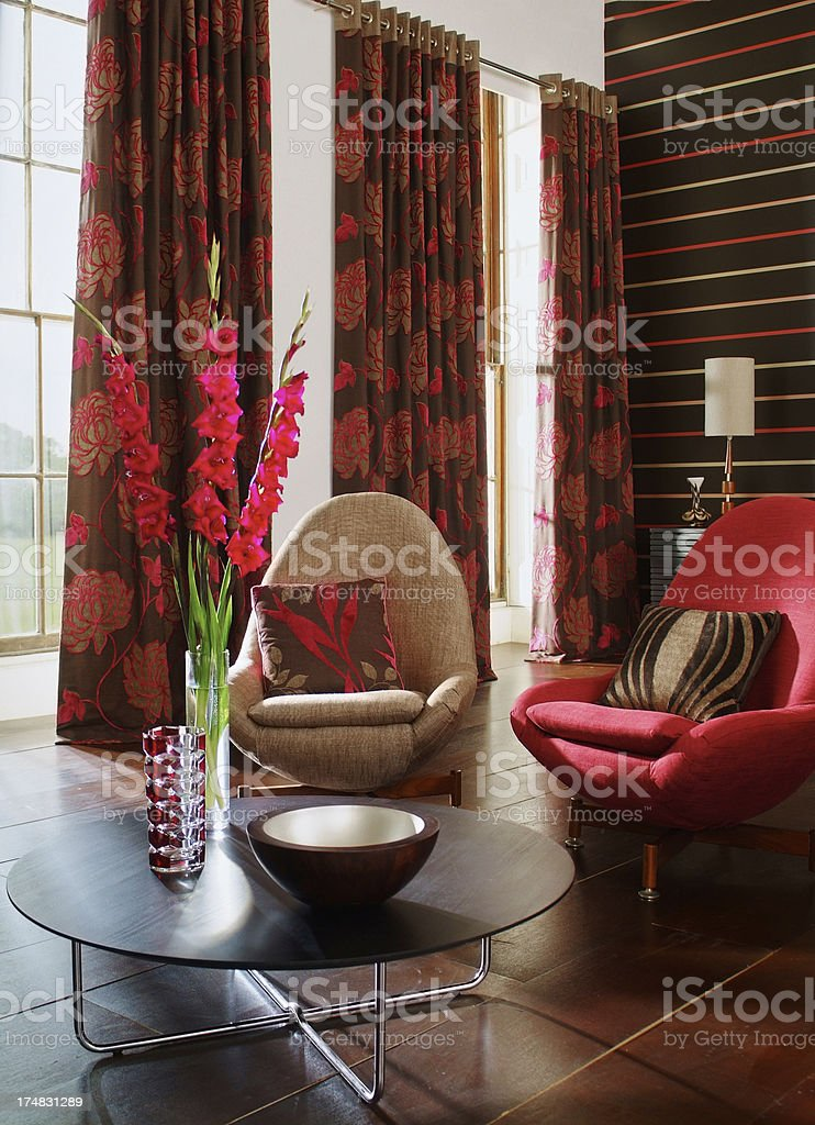 Interior of trendy chairs in colourful living room stock photo