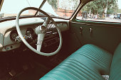 interior of vintage car. vintage classic style. retro film color filter effect.