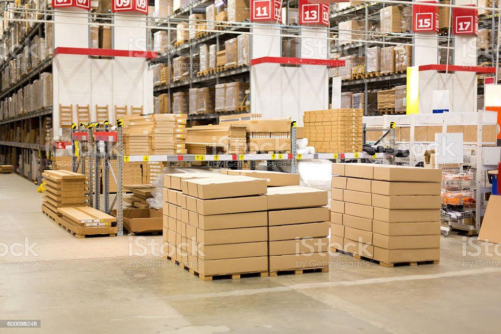 interior of warehouse. Rows of shelves with boxes stock photo