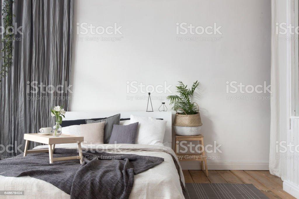 Interior of white and gray cozy bedroom stock photo