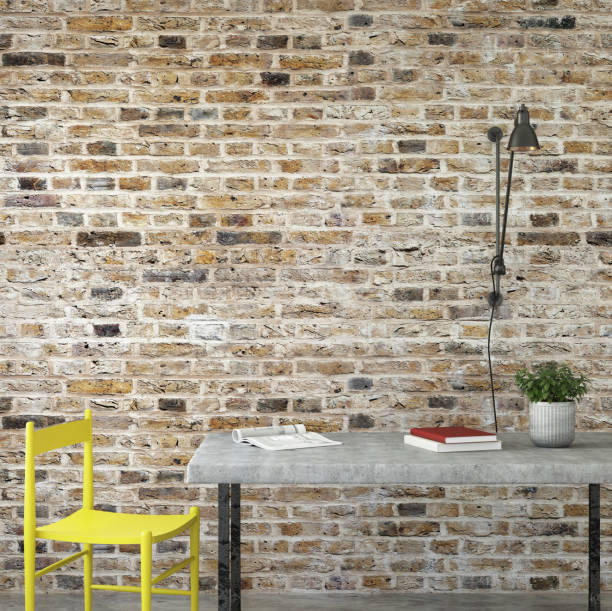 interior office desk with chair and brick wall stock photo