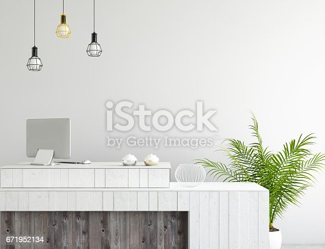 648050486istockphoto interior office lobby desk with large PC monitor and a blank wall 671952134