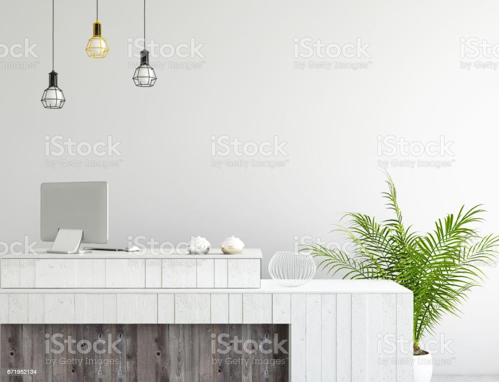 interior office lobby desk with large PC monitor and a blank wall stock photo